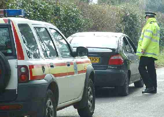 Sussex Police car and officer Hamer Lane morning raid
