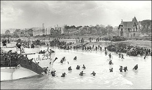Troops of the Canadian 3rd Divisionand the 2nd Canadian Armoured Brigade land on Juno Beach.