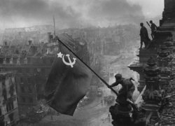 Berlin fell to the Red Army on 2 May. Here, the Hammer and Sickle is flown over the Reichstag