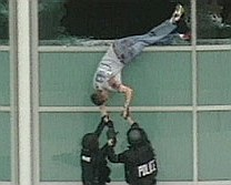Columbine High School Library victim Patrick Ireland being pulled from library windows after the massacre