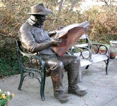 Reading the newspaper: Brookgreen Gardens in Pawleys Island, South Carolina, United States