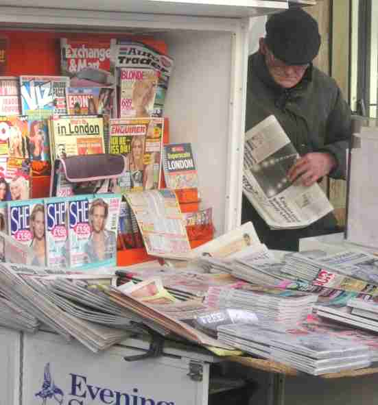 Newspaper vendor, Paddington, London, February 2005