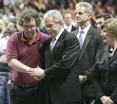 President George W. Bush shakes the hand of the Virginia Tech Student Government Association's President James Tyger following his speech at the school
