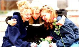 Columbine School friends of the shooting victims comfort each other during a memorial service